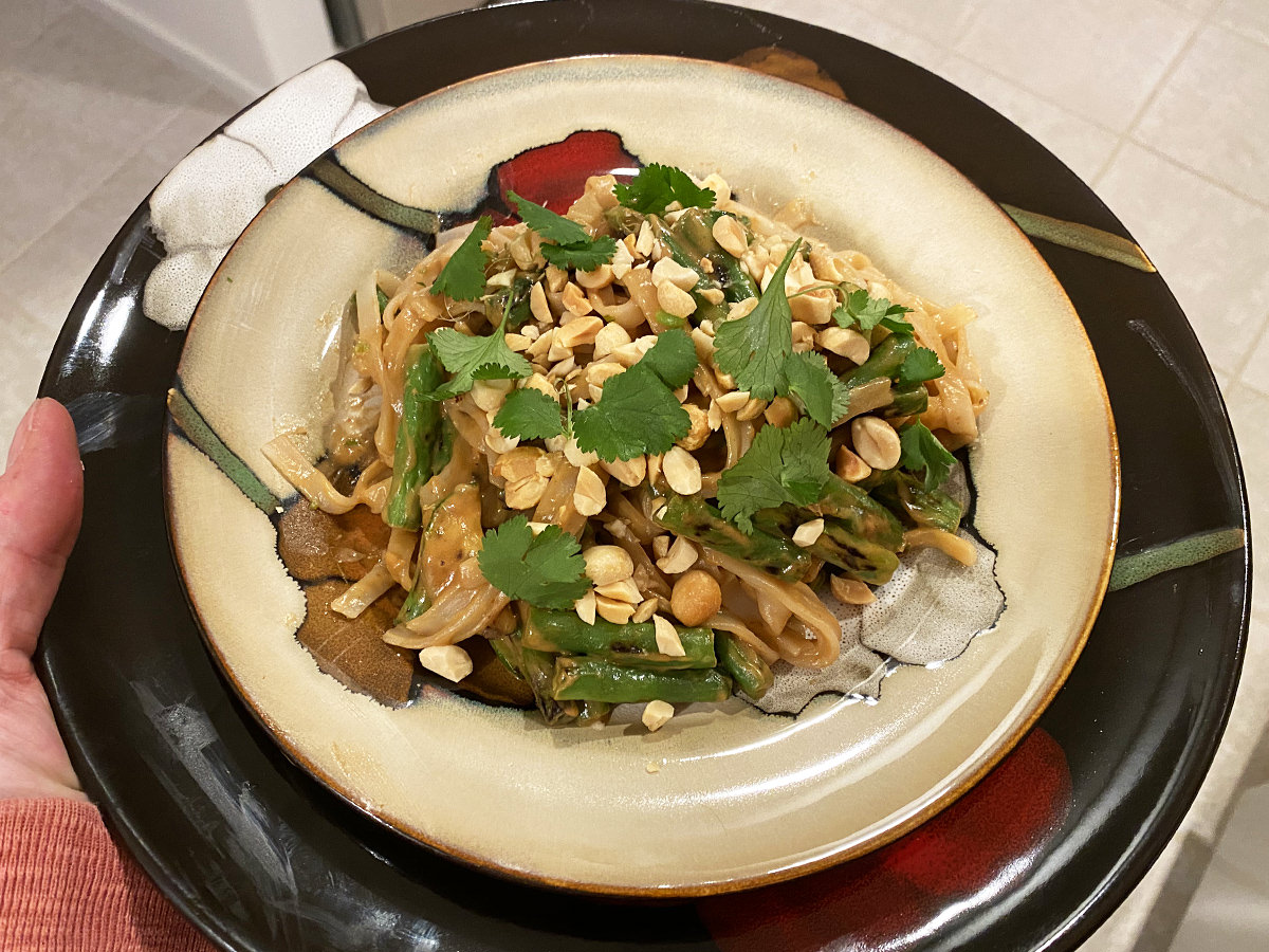 My dinner. It's a plate of rice pasta with spicy peanut sauce and blackened zuccini and green beans with cilantro and peanuts.