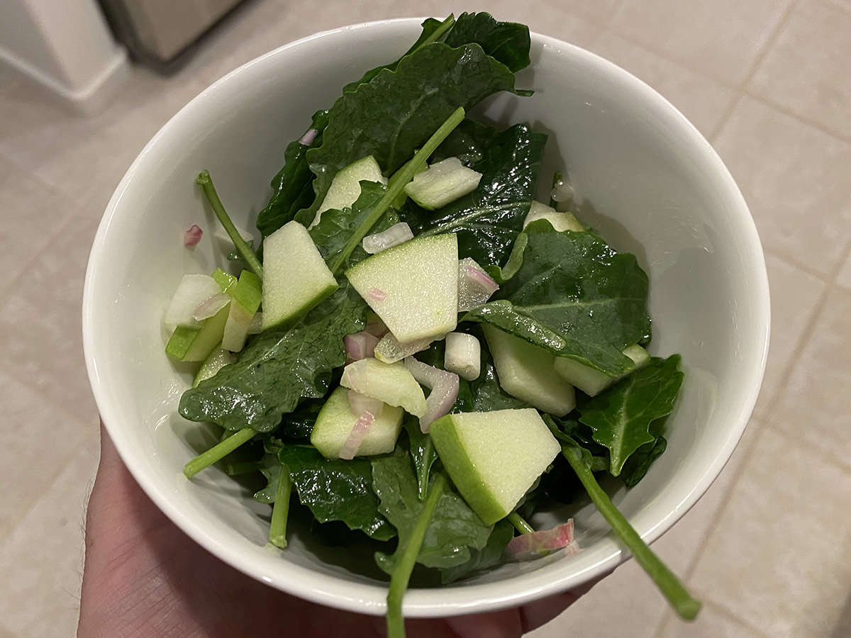 My side salad. A bowl of kale with greasy apple dressing on top.