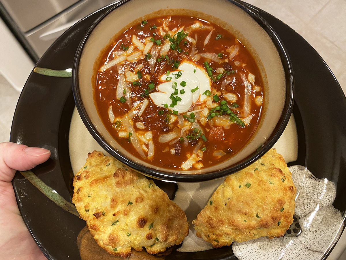 My dinner. It's a bowl of black bean soup with sour cream and chives pluse a cheddar biscuit.