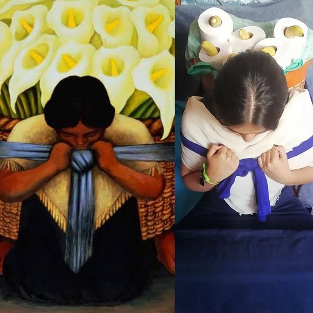 A woman recreates the painting by Diego Rivera called The Flower Bearer.