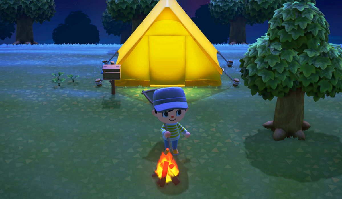 My character sitting by a campfire in front of my tent at night time.