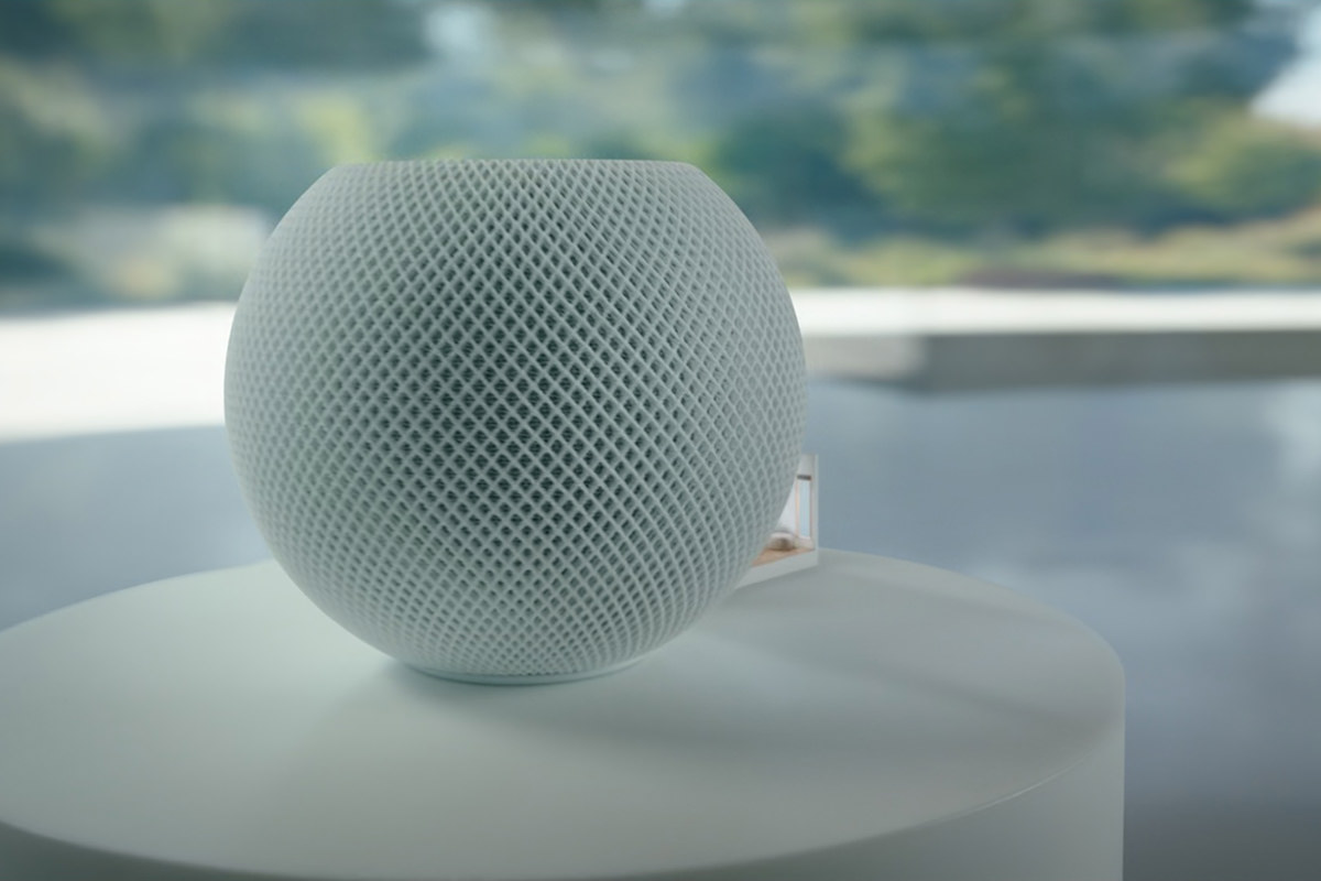 Zooming in on the little HomePod mini speaker.