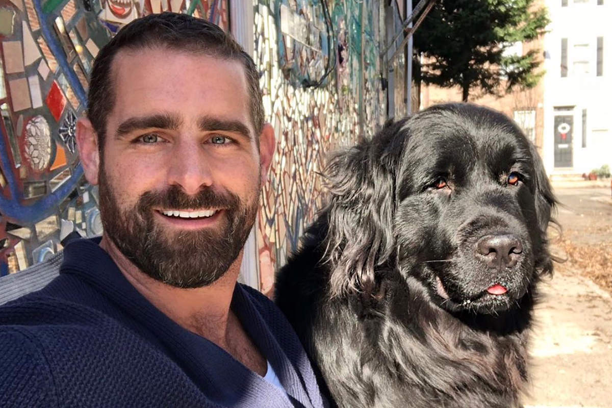 Brian Sims looking gorgeous and hanging out with his dog.