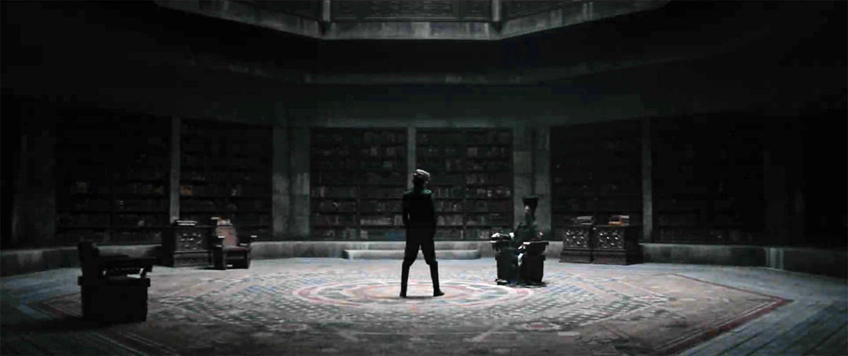 A massive stone study with books lining the walls. Paul is facing down the Reverend Mother who is seated with a box at her hand.