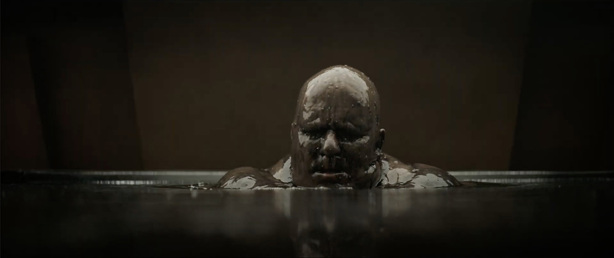 Stellan Skarsgård as Baron Vladamir Harkonnen, rising from the mud.