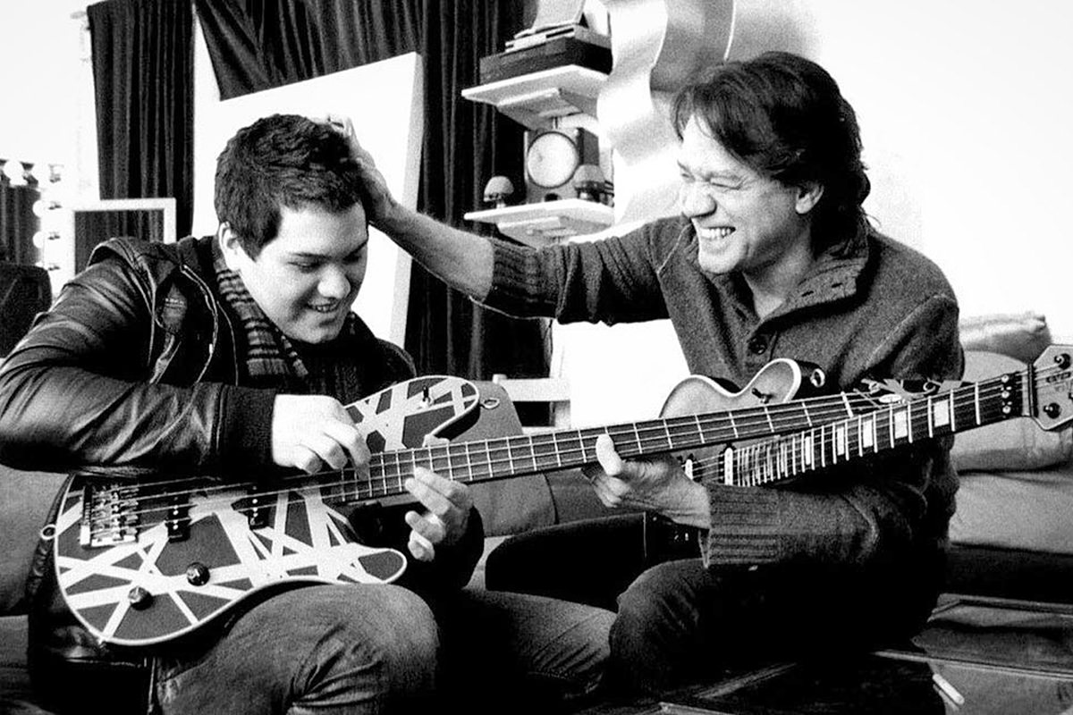 Eddie Van Halen playing guitar with his son Wolfgang Van Halen