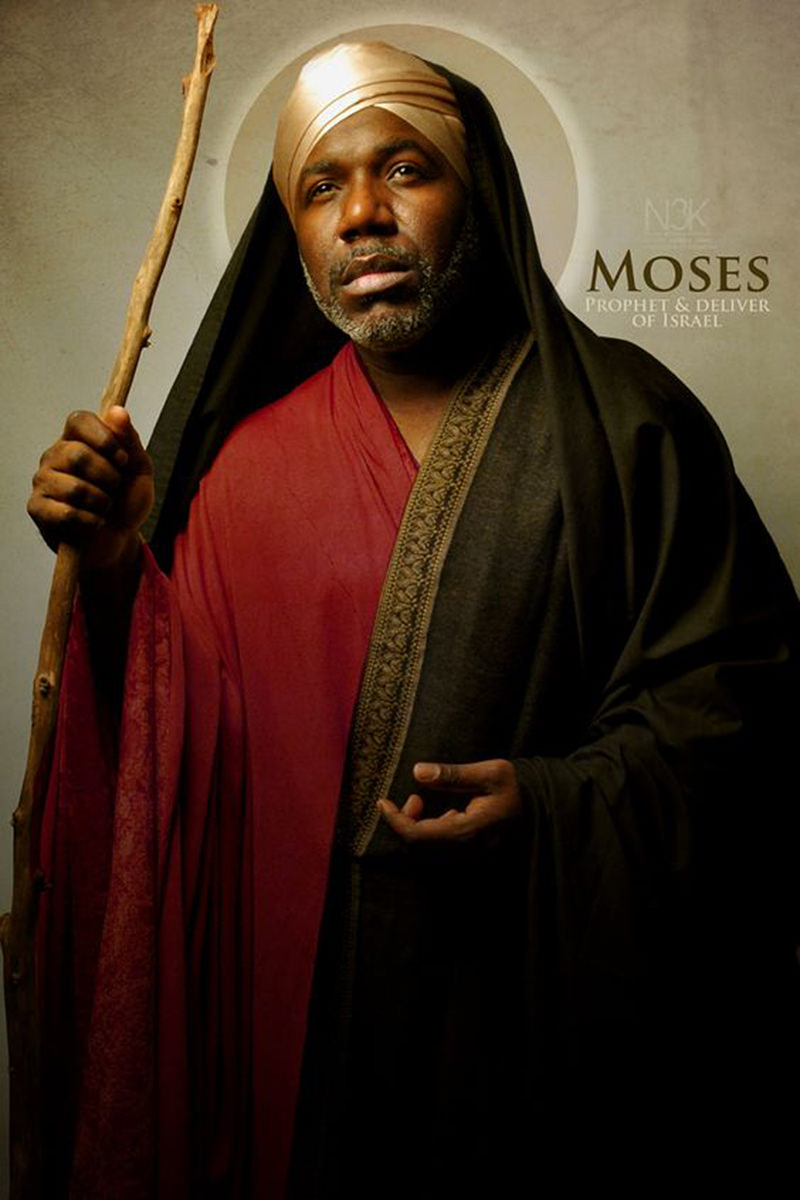 Apostle Moses with a halo behind his head, holding a wooden branch as a staff as photographed by James Lewis..