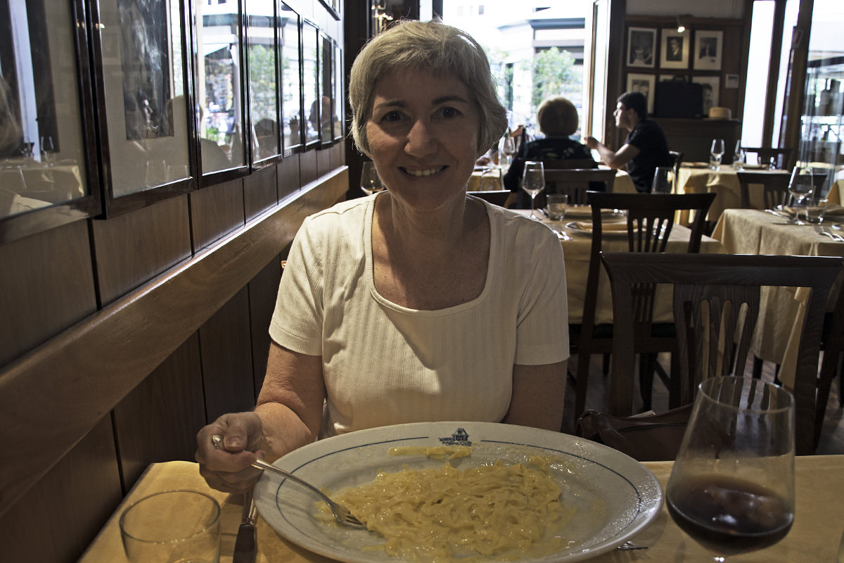Mom with her giant plate of Fettucini Alfredo at the restaurant where it was invented.