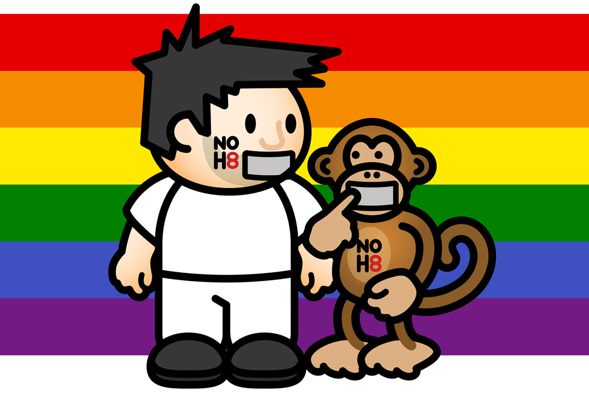 Lil' Dave and Bad Monkey with NOH8 written on them in front of the PRIDE flag.