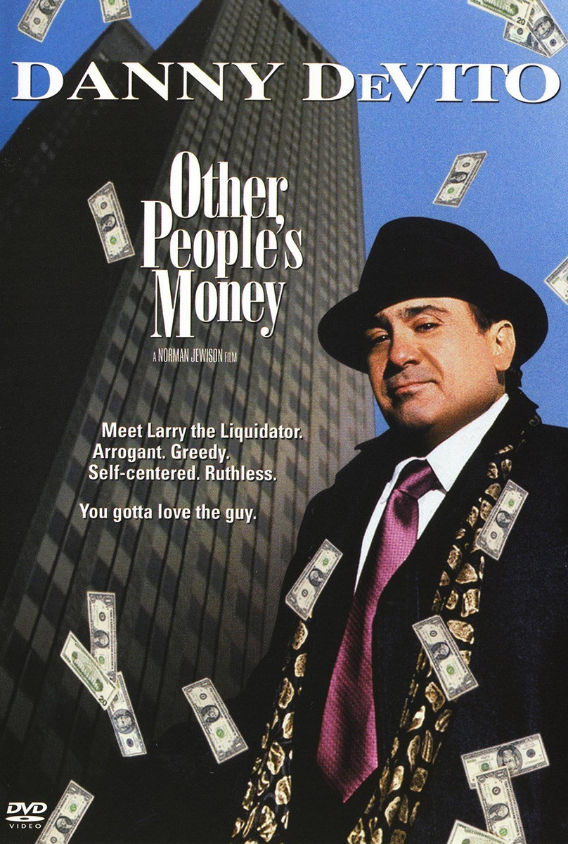 The movie poster for Other People's Money with Danny DeVito being showered with money as he stands in a suit and tie with a Wall St. Building behind him.