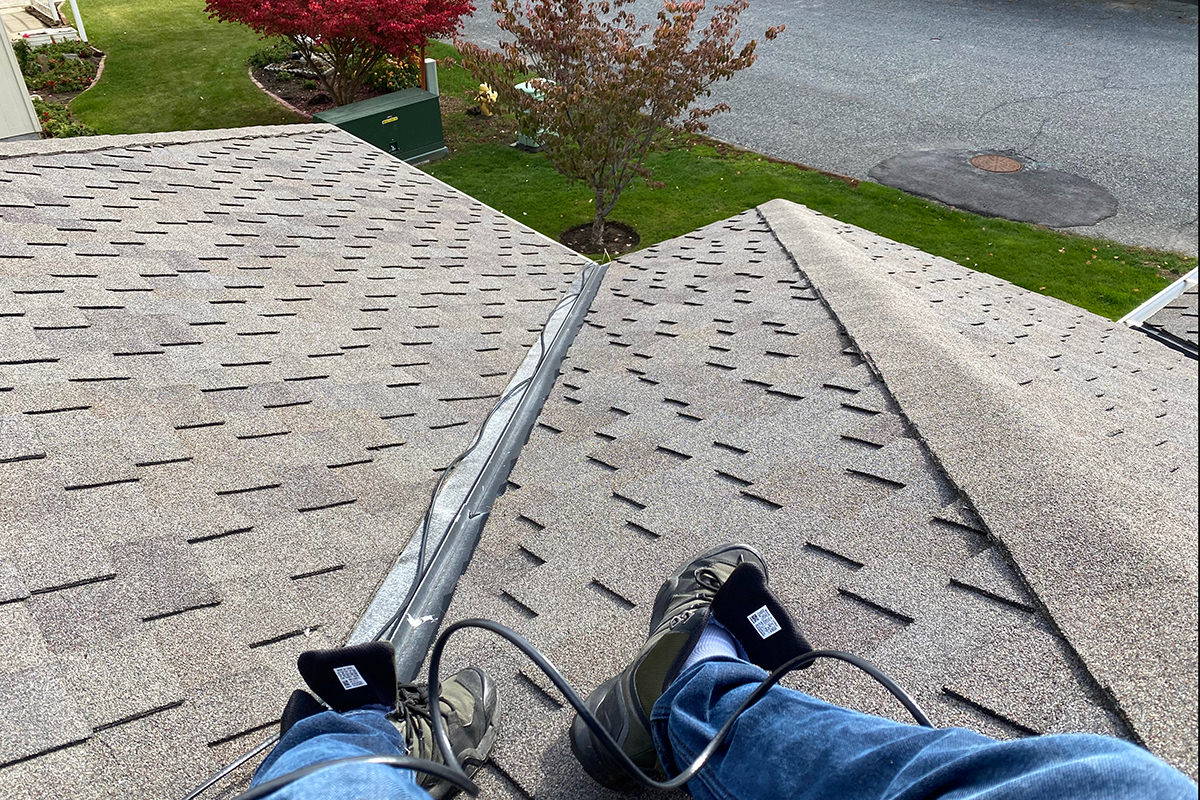 Me sitting on top of my roof