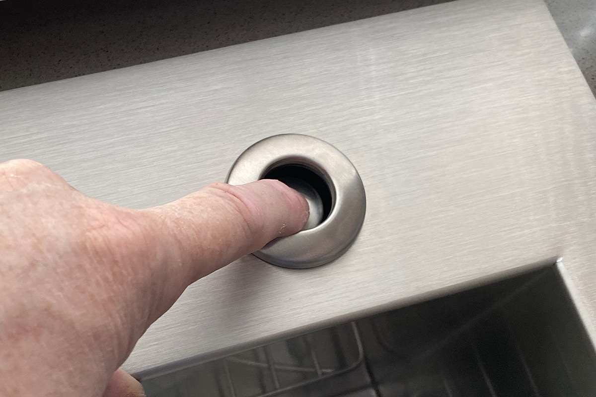 Pressing a button installed on my sink rim.