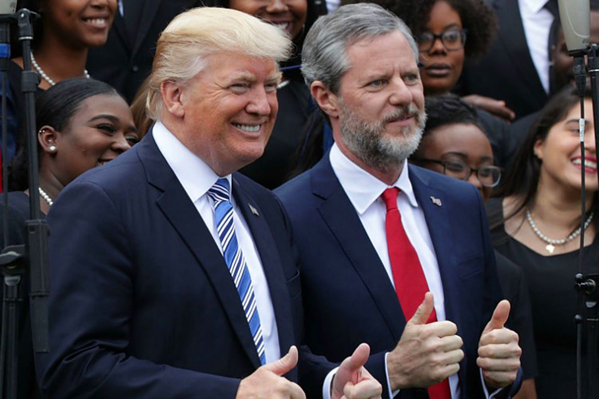 President Trump and Jerry Falwell Jr. giving the double-thumbs-up and looking like the assholes they are.