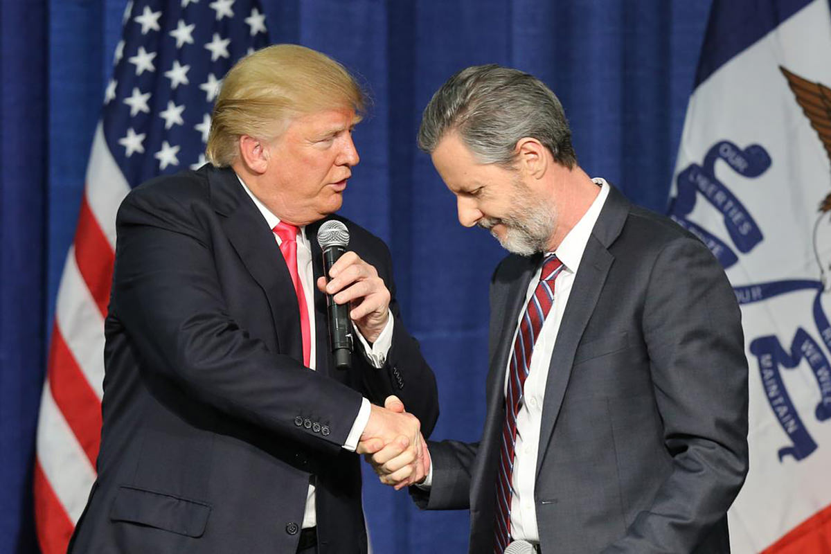 President Trump shaking Jerry Falwell Jr.'s hand while both are looking like the assholes they are.