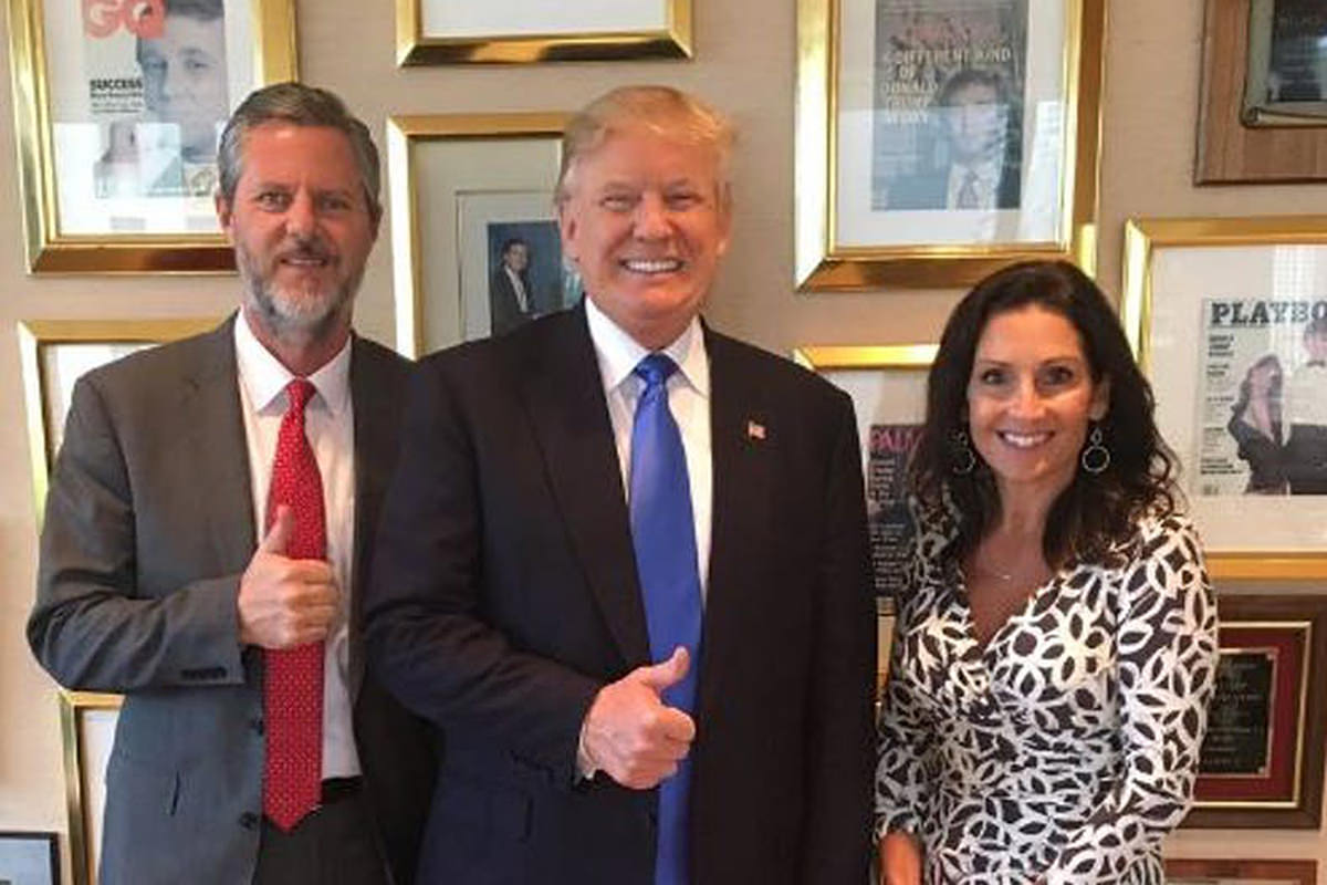 President Trump and Jerry Falwell Jr. giving the thumbs-up while standing with Falwell's wife and looking like the trio of assholes they are.