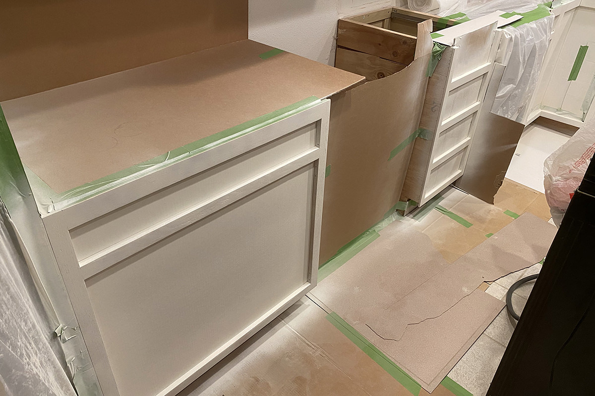 A mess in my kitchen as my cabinets get painted.
