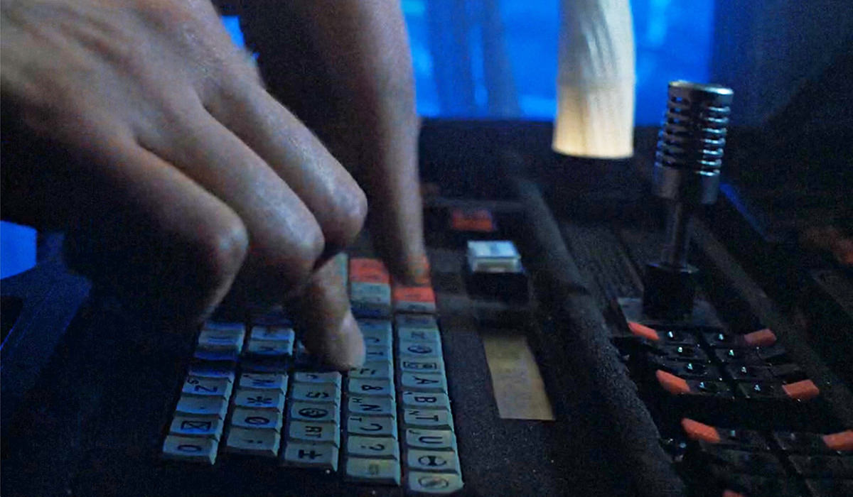 Bishop's fingers flying across the keyboard.