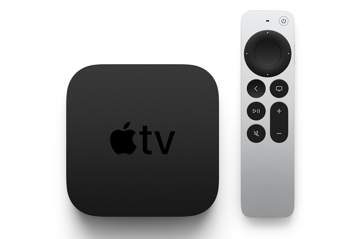 Apple TV remote in the hand.
