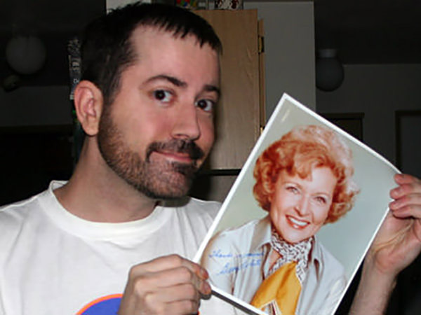 Me with an autographed photo of Betty White.