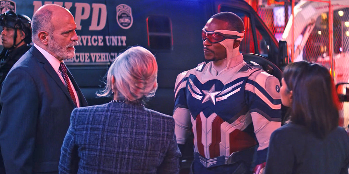 Sam Wilson talking to the UN delegates as Captain America while the world watches.