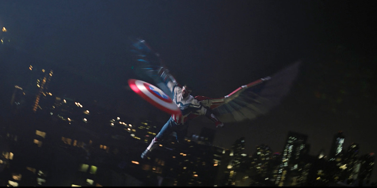 Captain America flying in the night sky, throwing his shield through a skyscraper window.