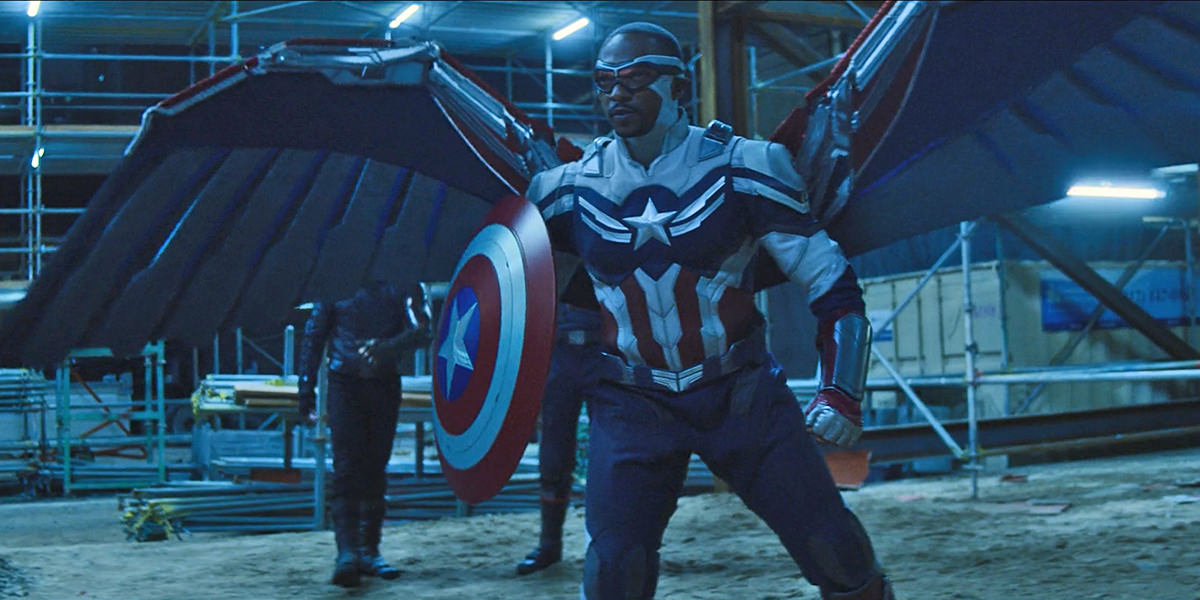 Captain America with his shield and wings facing off with Flag Smashers at a construction site.