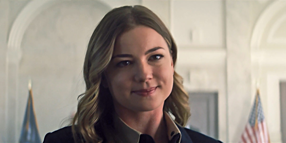 Sharon Carter walking away from her pardoning hearing with an evil smile on her face.