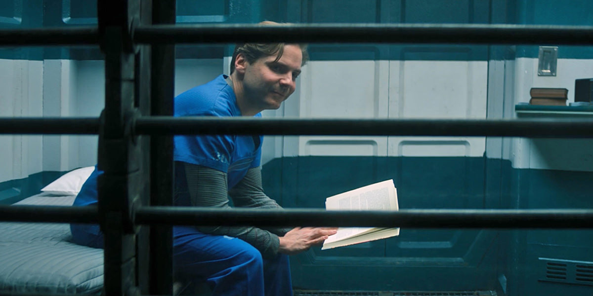 Baron Zemo sitting in prison and smiling.