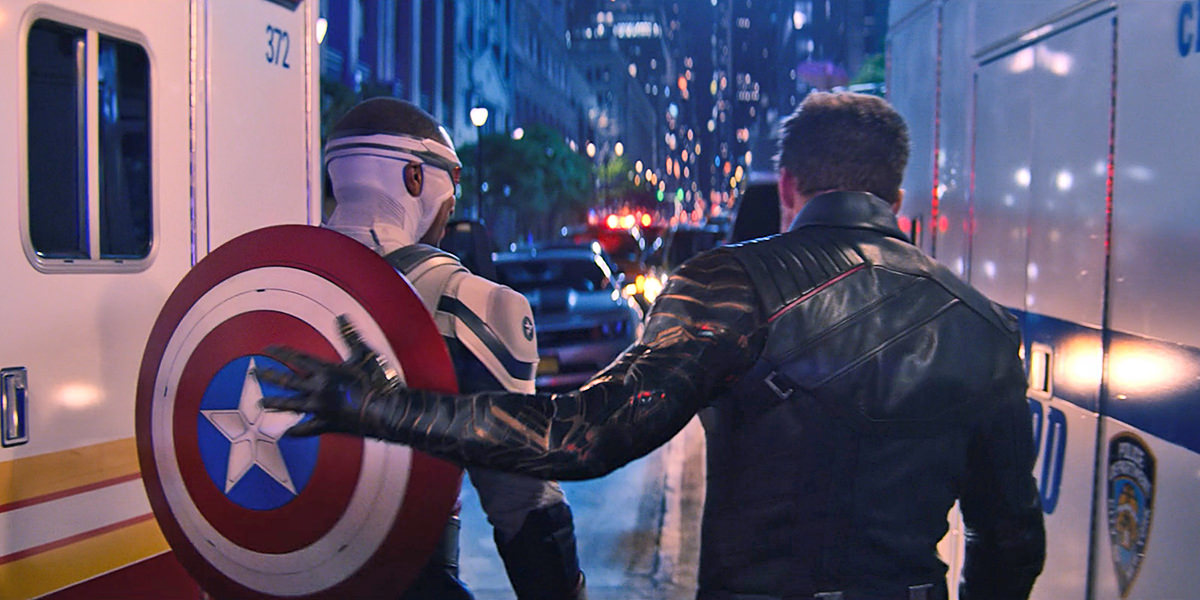 Bucky patting Cap on the back as they leave.