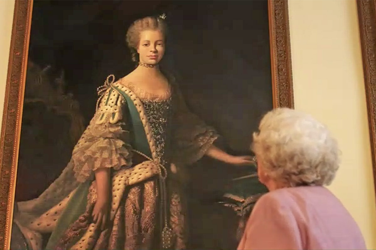 Lifetime Movie: The Queen looking up at a portrait of Queen Charlotte.