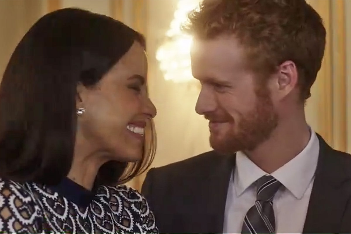 Lifetime Movie: Harry and Meghan looking at each other happily.