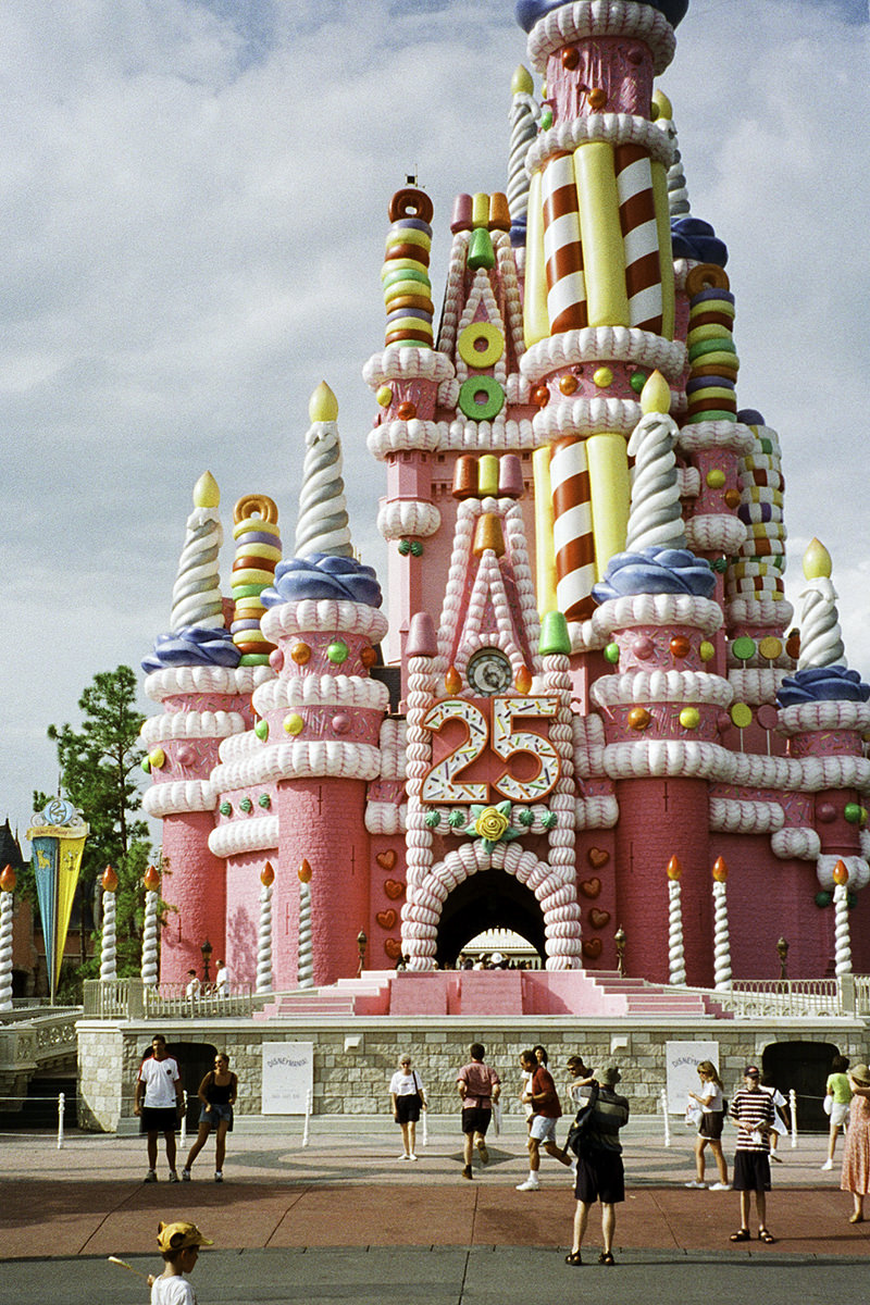 The hideous Cinderella Castle Birthday Cake all gaudy in pink and yellow.