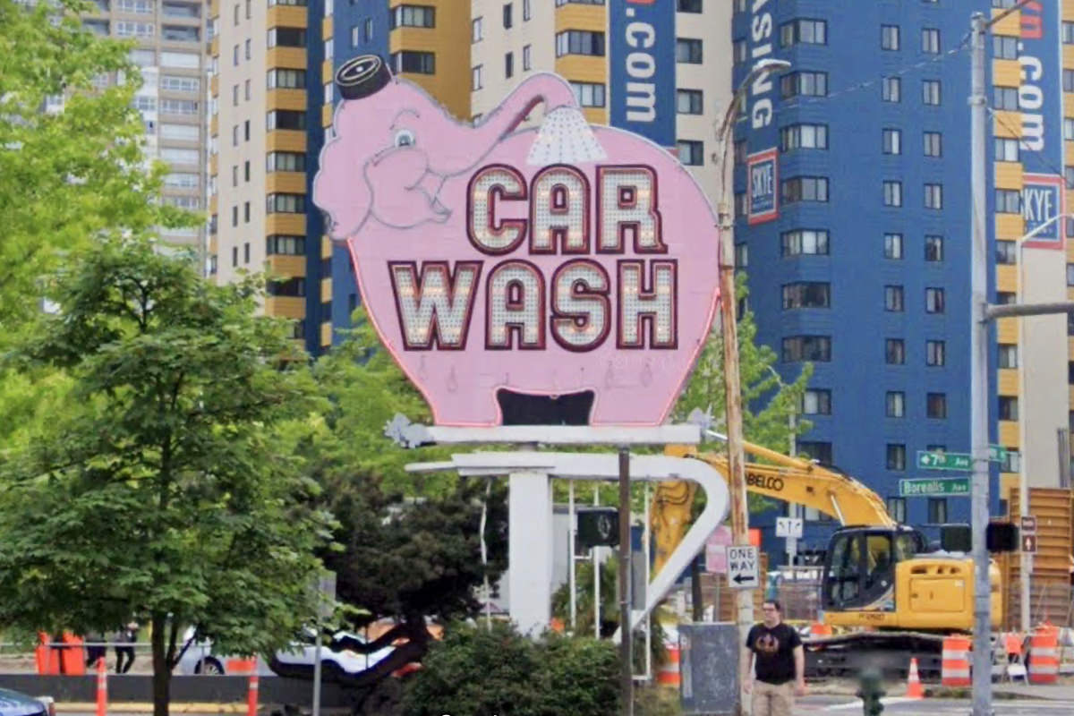 The pink elephant Car Wash sign on a Seattle street.