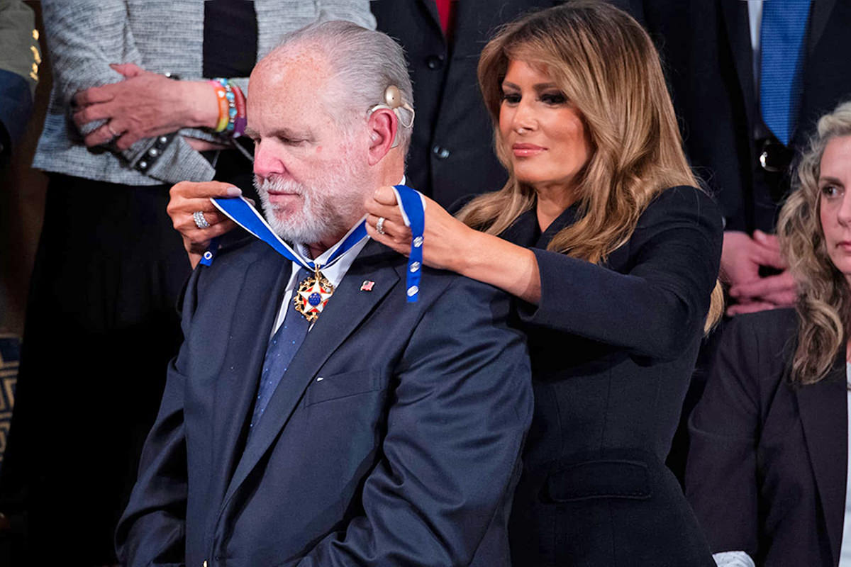Former First Lady Melania Trump puts the Presidential Medal of Freedom around Rush Limbaugh's neck.