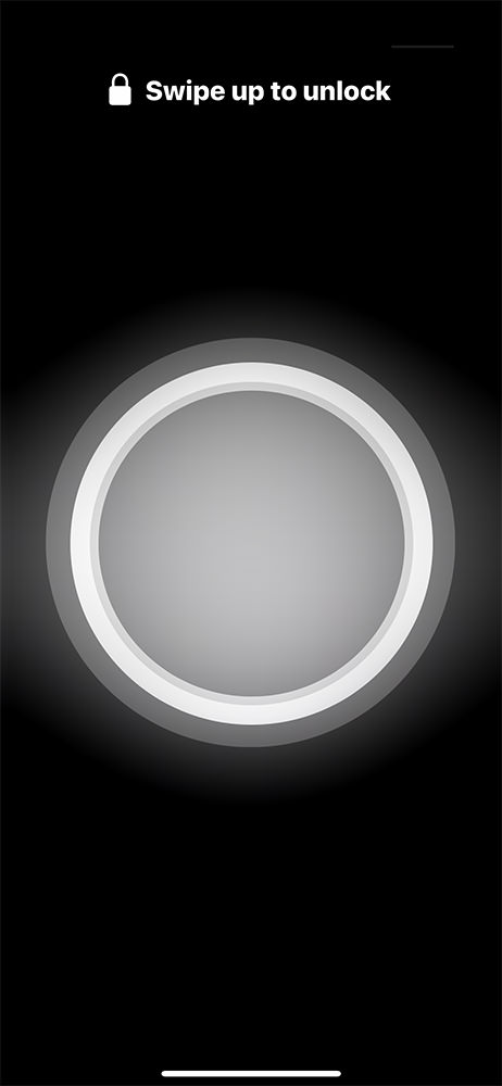 A glowing white ring appears on the iPhone display.