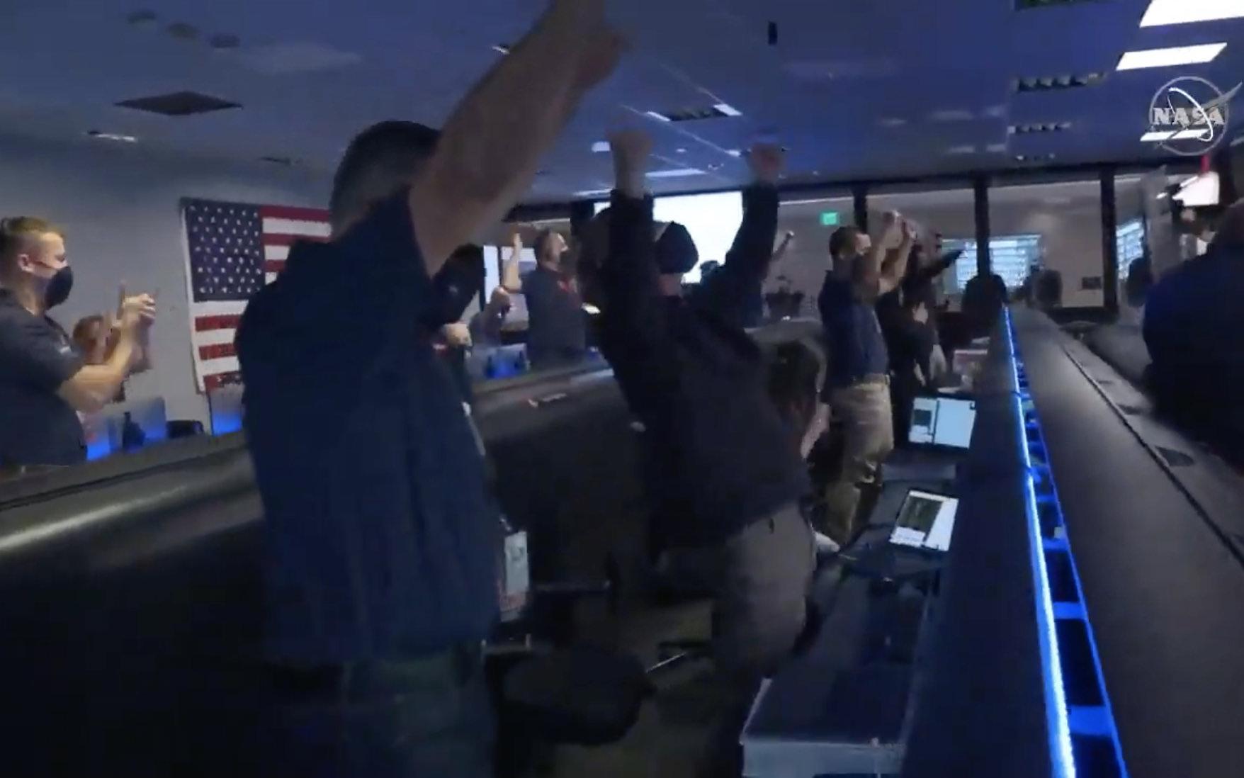NASA engineers celebrating the successful landing.