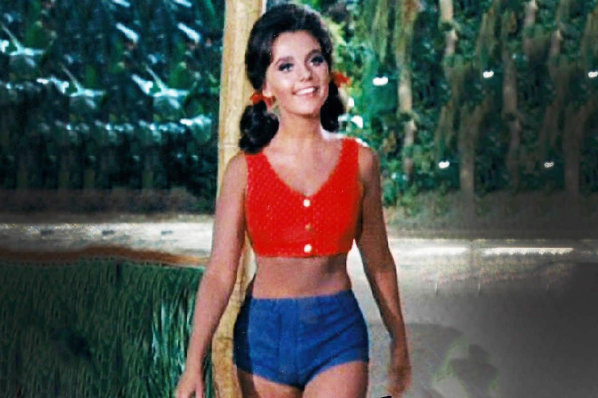 Dawn Wells as Mary Ann on Giligan's Island wearing shorts and a halter top and looking gorgeous.