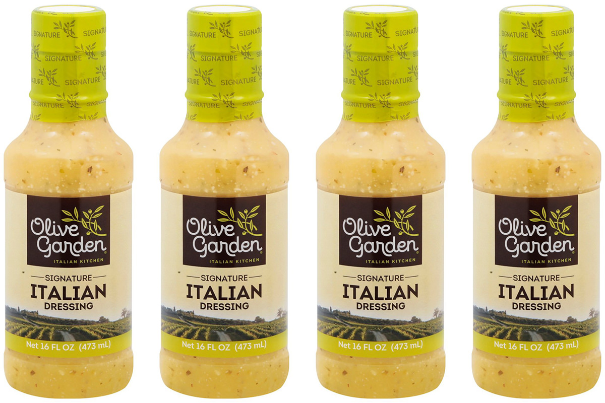 Four bottles of Olive Garden Signature Italian Dressing.
