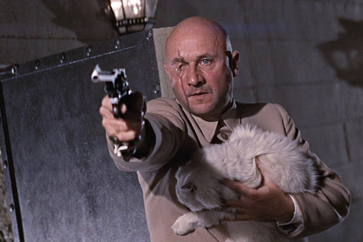 Donald Pleasence as Blofeld... pointing a gun and holding a longhair white cat.