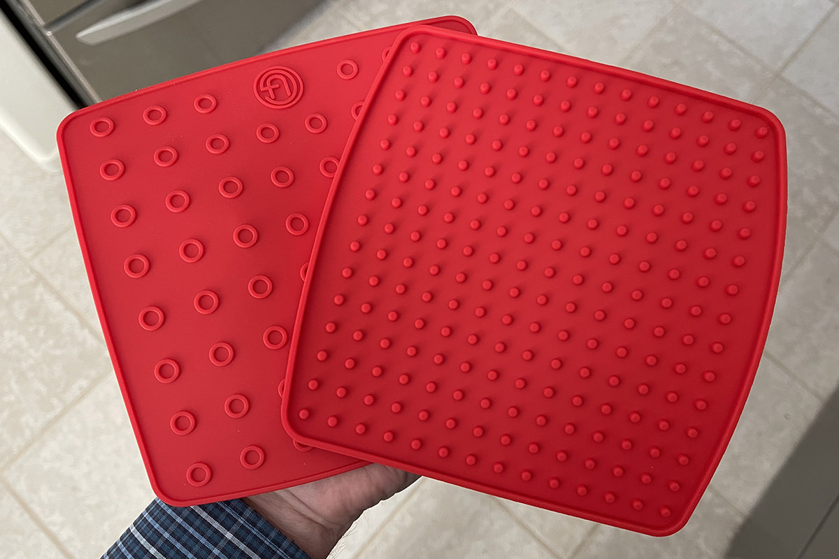 My two new silicone potholders all pretty and red.