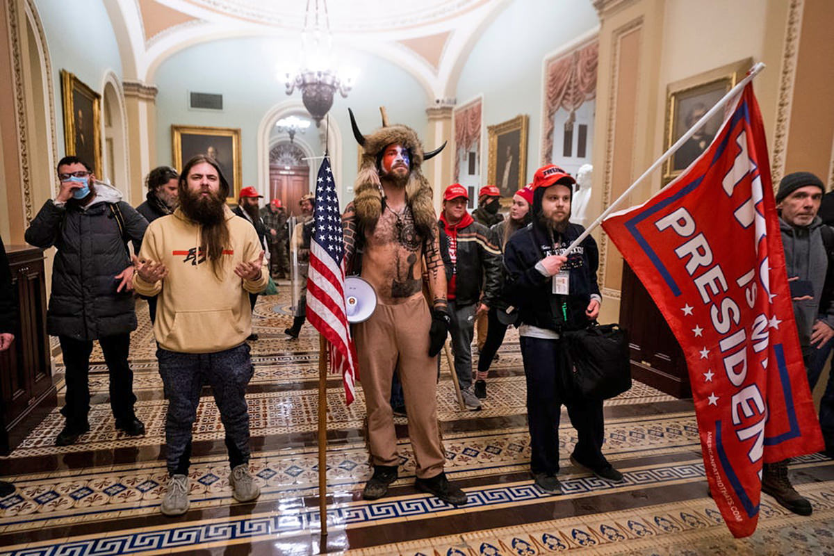 A bunch of white people storming the Capitol... one of them dressed up in viking horns.