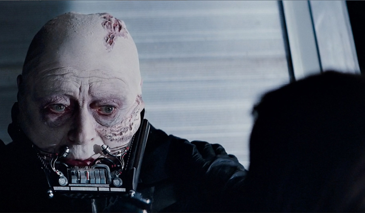 Darth Vader's beautiful black visage is stripped away to reveal a crusty old white man!