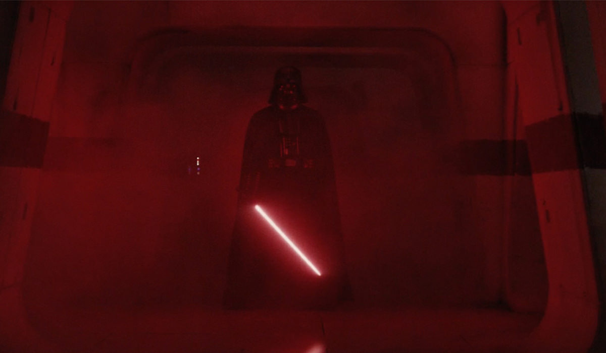 Darth Vader appears, red lightsaber glowing!