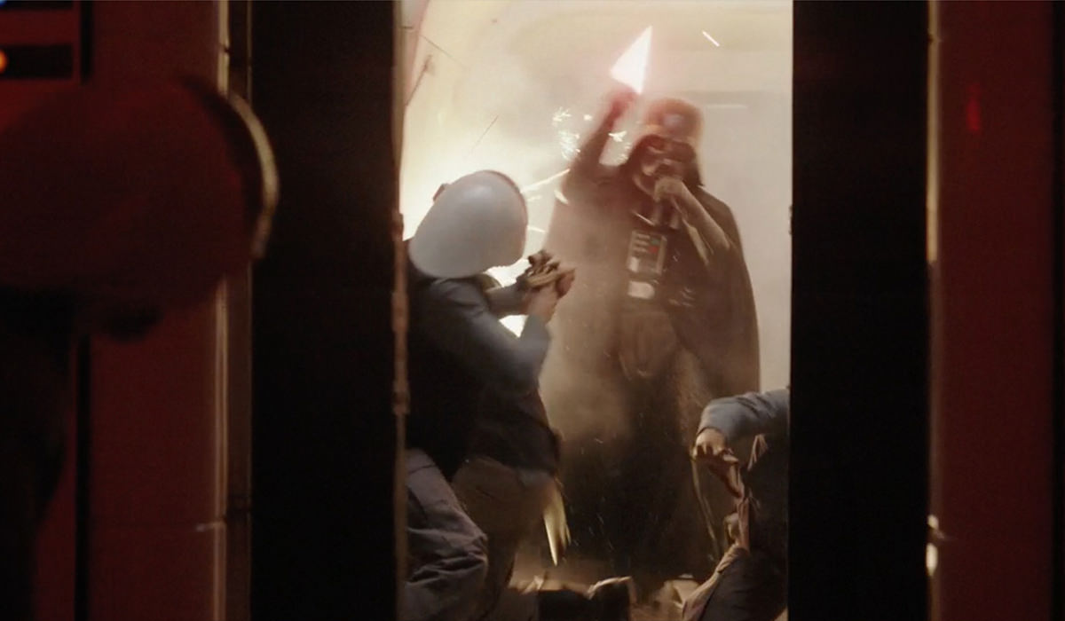 Darth Vader embattled as the door closes!