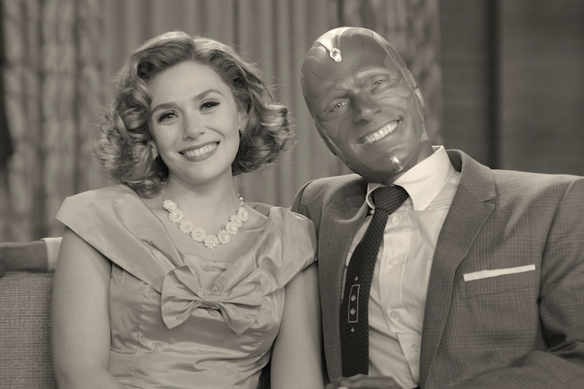 Vision and Wanda in black-and-white sitting in a 50's sitcom.