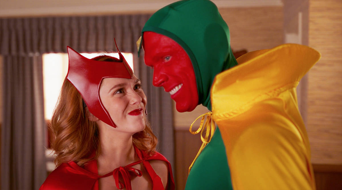 Wanda and Vision wearing their comic book costumes for Scarlet Witch and Vision as Halloween costumes.