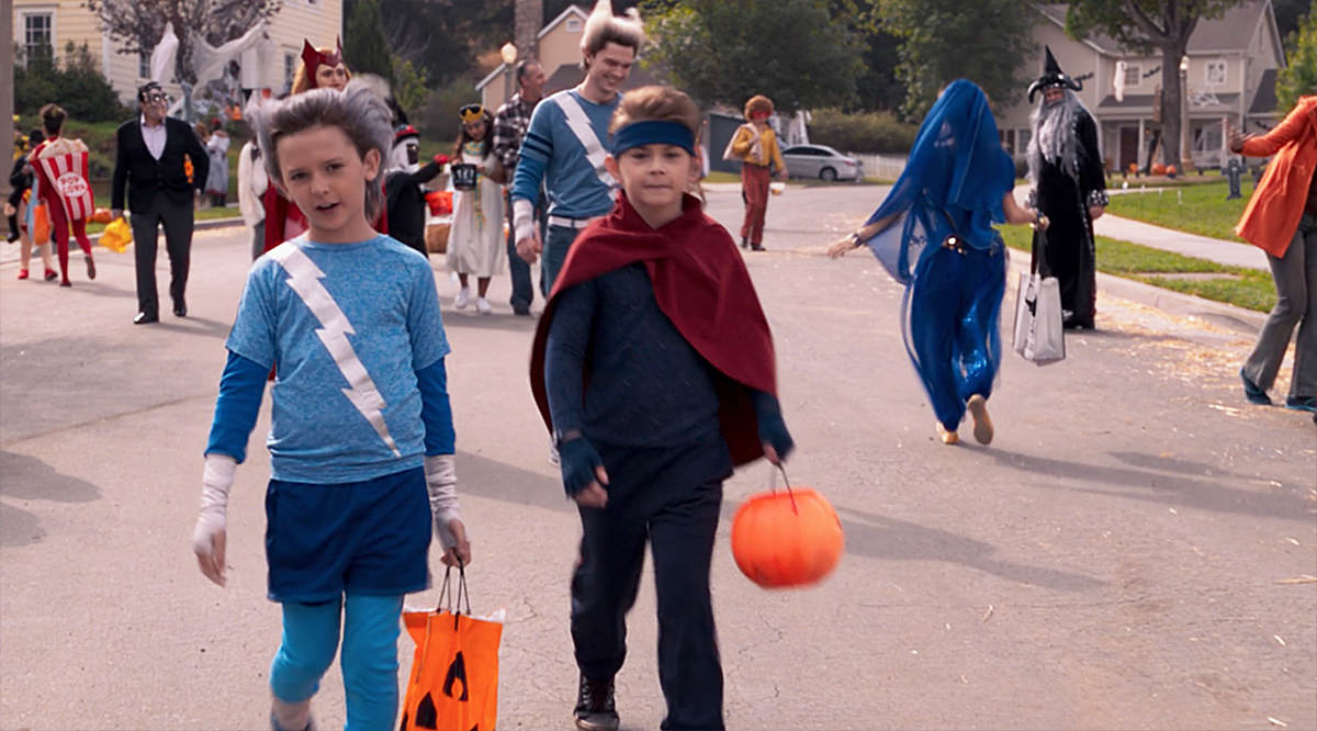 Wanda and Vision's children in their Speed and Wiccan comic book costumes as Halloween costumes.