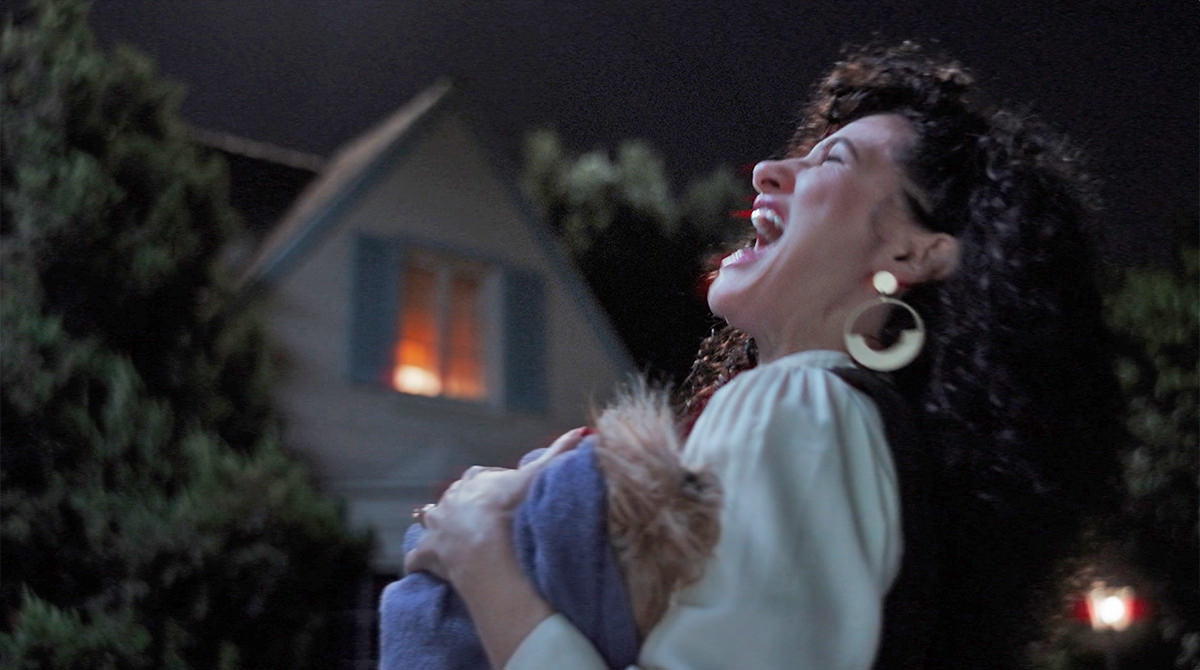 Agnes laughing her head off while holding the body of Billy and Tommy's dead dog Sparky!