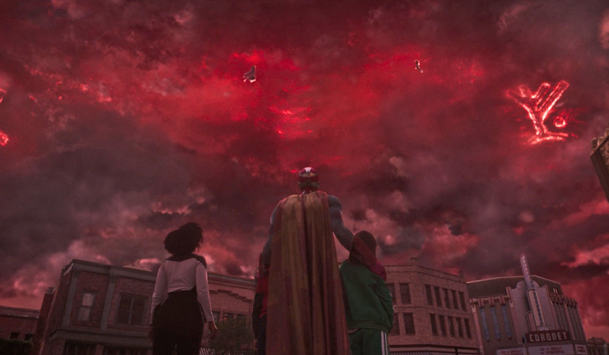 Wanda floating in red skies battling Agatha Harkness while Vision and her children look upward.