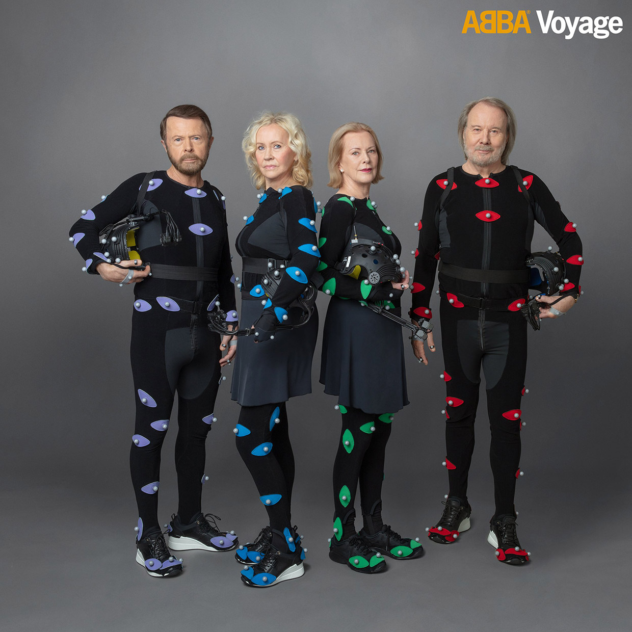 ABBA standing in their VR suits.